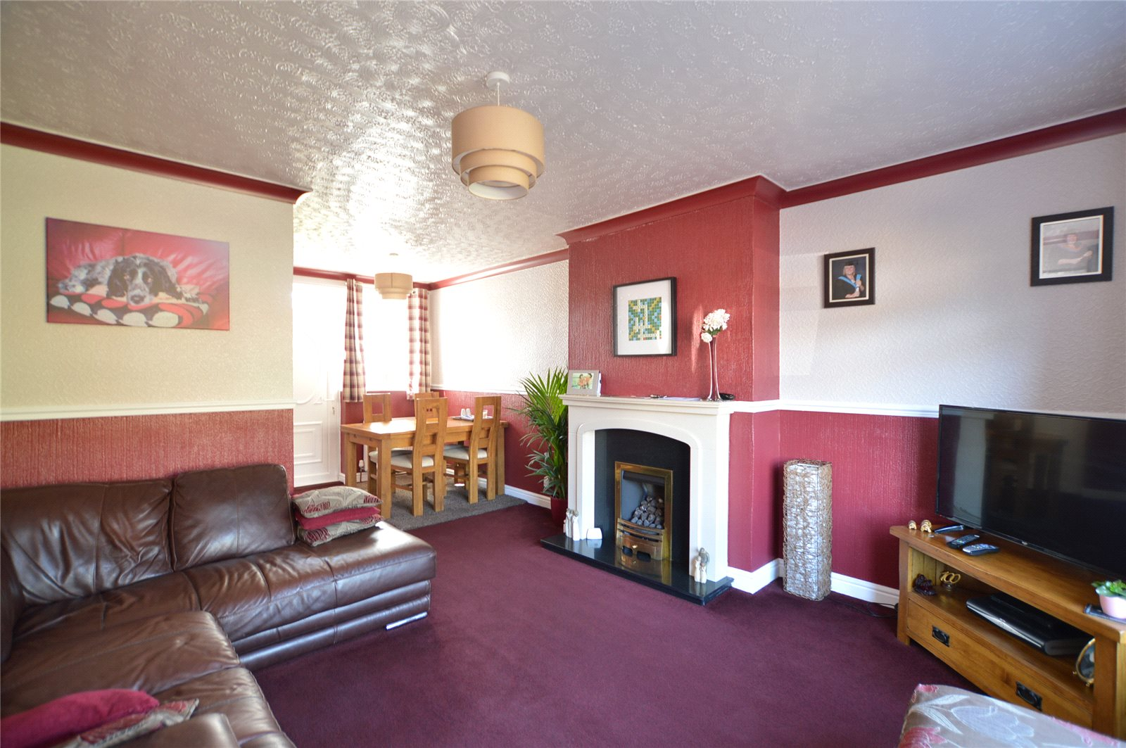 Property for sale in Morley, interior reception room, spacious with leather corner sofa and fireplace
