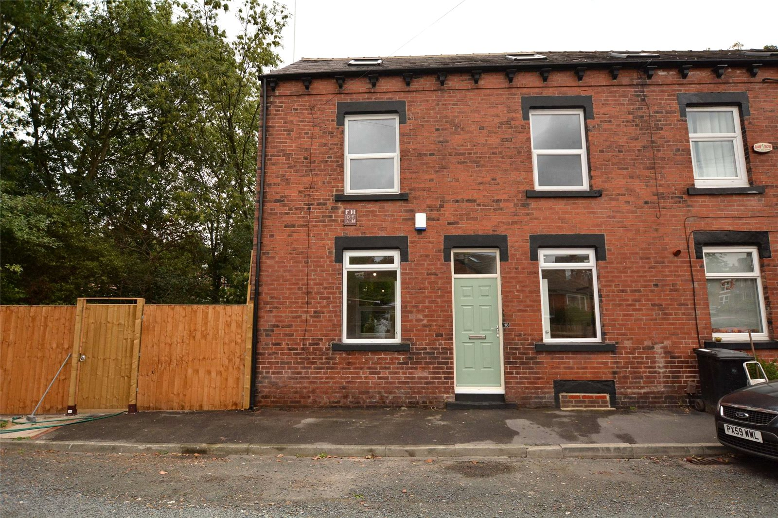 Property for sale in Leeds, exterior of red brick semi detached home