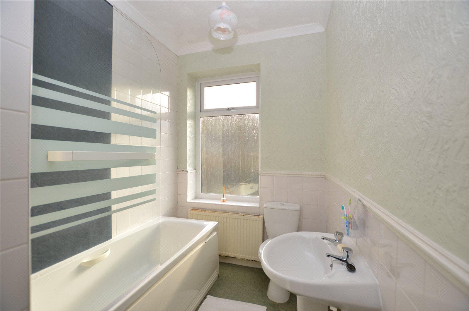 Property for sale in Batley, interior white bathroom suite