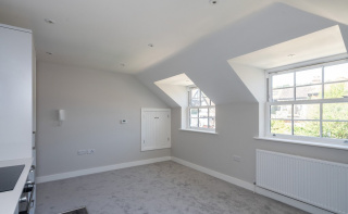 A stunning brand new apartment in the centre of Shere with PARKING